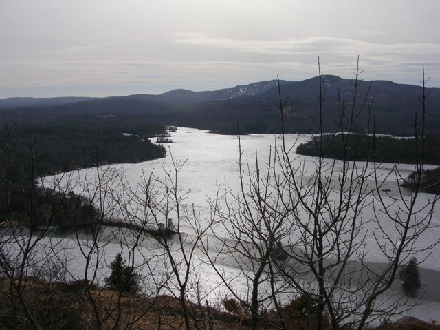 View across an icy Lake Megunticook from Maiden Cliff